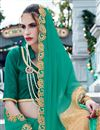photo of Designer Georgette And Net Party Wear Saree With Embroidery In Green And Beige Color