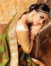 photo of Attractive Green And Cream Color Party Wear Silk And Net Designer Saree