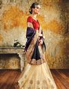 photo of Artistically Embroidered Party Wear Silk And Net Designer Saree In Purple And Cream Color