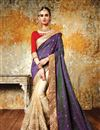 image of Artistically Embroidered Party Wear Silk And Net Designer Saree In Purple And Cream Color