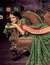photo of Weaving Designs On Chiffon And Brasso Fabric Dark Green Party Wear Saree