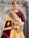 photo of Fabulously Embroidered Cream Color Designer Saree In Georgette And Net Fabric