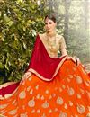 photo of Navratri Special Fancy Net Orange Embellished Lehenga