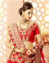 photo of Embroidery Designs On Red Art Silk And Satin Reception Wear Lehenga Choli