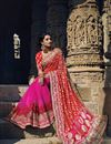 image of Red-Magenta Embroidered Wedding Wear Net Saree