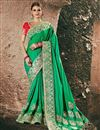 image of Embellished Art Silk And Satin Green Fancy Saree With Heavy Blouse