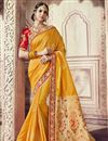 image of Wedding Wear Mustard Banarasi Silk Traditional Saree With Work