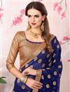 photo of Zari Embroidery Work Navy Blue Fancy Saree In Georgette With Lace Border