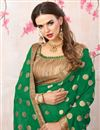 photo of Zari Embroidery Work Green Georgette Heavy Saree With Lace Border