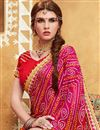 photo of Red And Pink Color Bandhani Style Party Wear Saree With Raw Silk Unstitched Designer Blouse