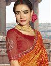 photo of Georgette Fabric Orange Fancy Festive Wear Bandhani Printed Saree