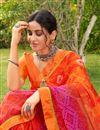 photo of Festive Wear Orange Color Satin Fabric Fancy Bandhej Print Saree
