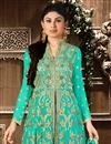 photo of Mouni Roy Sea Green Color Georgette And Santoon Sharara Top Lehenga