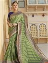 image of Function Wear Silk Fabric Trendy Weaving Work Saree In Green Color