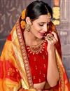 photo of Designer Fancy Silk Red And Orange Color Traditional Puja Wear Saree