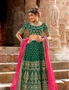 image of Net Fabric Dark Green Color Reception Wear Lehenga Choli With Embroidery Work