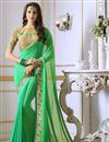 image of Embellished Designer Party Wear Saree In Sea Green Georgette With Fancy Blouse