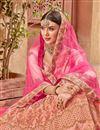 photo of Embroidered Wedding Wear Satin Silk Fabric Lehenga In Peach