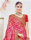 photo of Designer Wedding Wear Fancy Red And Magenta Color Net Fabric Embroidered Saree With Heavy Blouse
