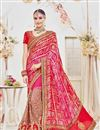 image of Designer Wedding Wear Fancy Red And Magenta Color Net Fabric Embroidered Saree With Heavy Blouse