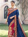 image of Soothingly Embroidered Crepe Silk And Georgette Fabric Bridal Wear Designer Blue And Pink Color Saree