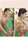 photo of Soothingly Embroidered Georgette Fabric Bridal Wear Designer Green Color Saree