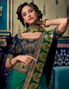 photo of Eid Special Fancy Fabric Dark Green Color Festive Wear Saree With Embroidery Work