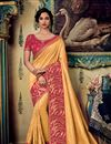 image of Eid Special Fancy Fabric Orange Wedding Wear Designer Saree With Embroidery Work