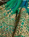 photograph of Wedding Function Wear Fancy Green Color Silk Long Embellished Anarkali Salwar Suit