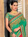 photo of Embroidery Work On Green Party Wear Saree In Art Silk And Net