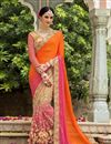 image of Bridal Wear Net And Fancy Silk Fabric Embroidered Designer Saree In Orange And Pink Color