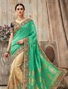 image of Artistically Embroidered Green And Beige Color Wedding Wear Fancy Fabric Saree
