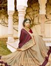 photo of Soothing Georgette And Net Fabric Party Wear Beige And Maroon Color Designer Saree With Embroidery Work