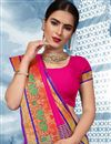 photo of Cotton Fabric Traditional Temple Wear Fancy Saree In Rani Color