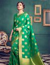 image of Party Wear Kanchivaram Style Silk Saree In Green Color With Weaving Designs