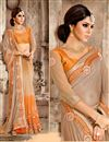 photo of Embroidered Designer Net And Georgette Saree In Chikoo And Orange Color