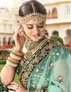 photo of Wedding Wear Dark Green Designer Embellished Lehenga In Velvet Fabric