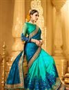 photo of Creatively Embroidery Design Fancy Fabric Blue And Turquoise Color Saree With Unstitched Blouse