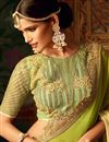 photo of Wedding Wear Green Color Georgette Fabric Designer Fancy Saree With Lace Border And Embroidered Blouse