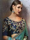 photo of Zari And Thread Work Embroidered Fancy Cyan Georgette Saree