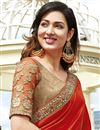 photo of Georgette And Net Fabric Wedding Wear Designer Saree In Orange Color With Blouse
