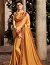 image of Function Wear Designer Fancy Fabric Mustard Saree With Embroidered Blouse