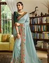 image of Eid Special Embroidered Light Cyan Wedding Wear Art Silk Fabric Saree With Blouse