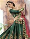 photo of Dark Green Sangeet Wear Designer Lehenga In Satin Fabric With Embroidery Work