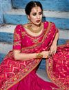 photo of Dazzling Embroidery Work On Rani Color Party Wear Saree In Fancy Fabric