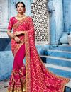 image of Dazzling Embroidery Work On Rani Color Party Wear Saree In Fancy Fabric