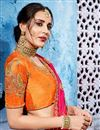 photo of Beguiling Embroidery Work On Orange Fancy Fabric Party Wear Saree