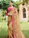 image of Designer Saree In Fancy Fabric Chikoo Color With Embroidery Work And Attractive Blouse