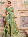 image of Green Banarasi Silk Festive Wear Saree With Border Work And Designer Blouse
