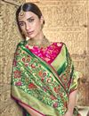 photo of Green Silk Fabric Traditional Wear Designer Weaving Work Saree With Heavy Blouse